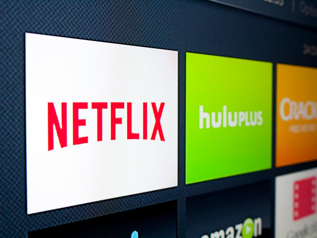 Netflix on a subscriber roll, and Wall Street sends stock soaring